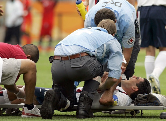 Claudio Reyna lies on a stretcher after getting injured on the play that gave Ghana the initial 1-0 lead during the USA vs Ghana World Cup Group E soccer match at the Franken Stadium in Nuremberg, Germany, Thursday, June 22, 2006. (AP Photo/Elise Amendola)
