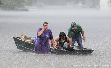 Dee Vazquez helps Georgette Centelo and her grandfather Lawrence Roberts after they tried to recover belonging from a family mobile home in Central, La., north of Baton Rouge on Aug. 15.