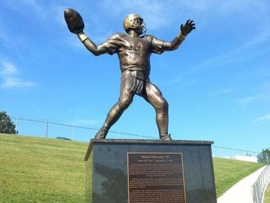 A statue at West Chester University's football field is dedicated to Hershey grad Michael Horrocks.