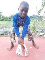 Philip Adeeri Fagbenro waits for a grounder in his native Nigeria using the glove he made out of cardboard.