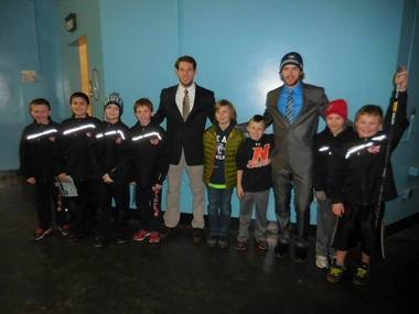 Catherman and Doughty with area youth players after the team's game with URI: photo by Derek Meluzio