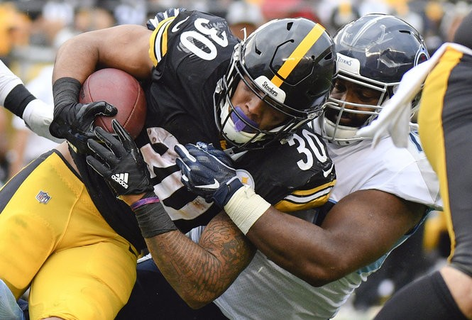 Pittsburgh Steelers running back James Conner (30) is hit by Tennessee  Titans defensive end e1cef78d7