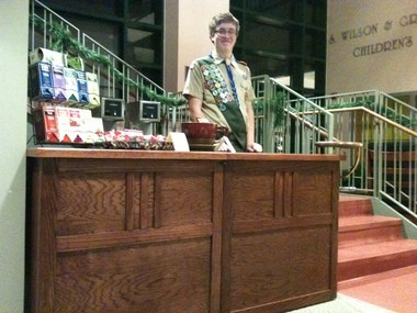 Eagle Scout candidate Brandon Loss with one of the three pieces of furniture he designed for the Cleve J. Fredricksen Library.