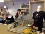 Stephanie Patterson Gilbert behind the counter of her Carlisle shop, Georgie Lou's Retro Candy and Gifts.
