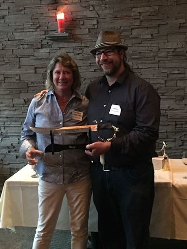 Owner Marianne Lieberman and winemaker Jef Stebben celebrate their 'best white' win Monday night at Nectar Restaurant.