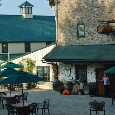 A patio allows for visitors to Boordy Vineyards to linger with wine and food outside the tasting room, which includes a tasting bar downstairs and an events room and bar upstairs.