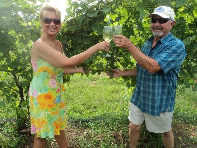 Gary Glocker, with his wife Suzanne, toast in the vineyard during a warm day in March 2017. They were toasting again recently when they heard their wine had won the Maryland Governor's Cup. We are very excited to find that wine lovers like our wines and that we have been able to get recognition so quickly,' he said.