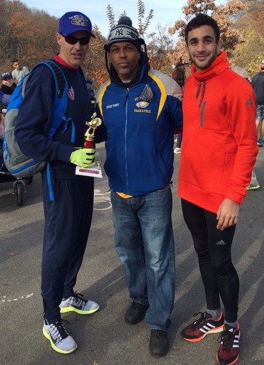 Rio Olympics-bound Robby Andrews, far right, poses with Island runners Jeff Benjamin, left, and Vinny Giles.