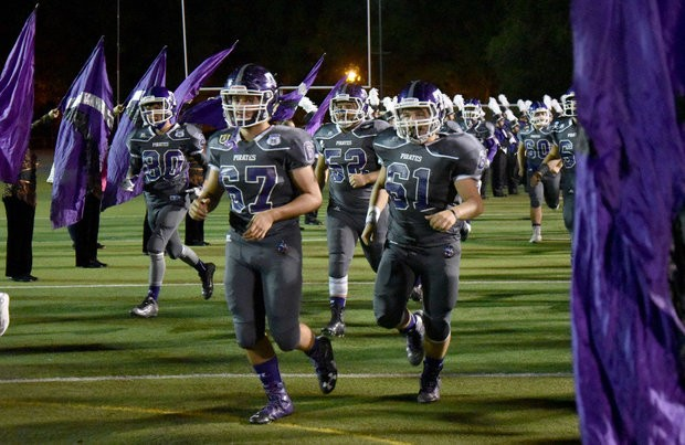 Tottenville HS football team taking field in 2016 game versus Erasmus Hall. Pirates will be attending Mangini Camp.