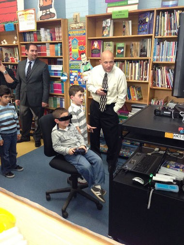 Nick Sheninger plays a video game developed by fellow students at PS 3 in Pleasant Plains.