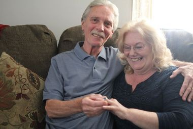 Stan and Elaine Ostapiak show off Stan's 1962 Seward Park High School class ring, which was stolen on the couple's wedding night and returned 42 years later. (Staten Island Advance/Vincent Barone)