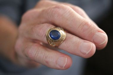 "Stan Ostapiak shows off his 1962 Seward Park High School class ring. ""It's really unbelievable that two strangers went through the trouble of doing this,"" said Ostapiak. ""That's what really got to me—what really impressed me. I'm so appreciative."" (Staten Island Advance/Vincent Barone)"