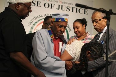 Eric Garner's wife, Esaw Garner breaks down during Rev. Al Sharpton's public address of the death of Eric Garner. Sharpton spoke publicly in Harlem at the National Action Network. (Staten Island Advance/Vincent Barone)