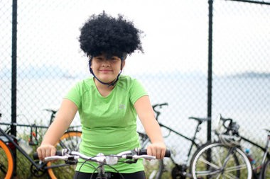 Cyclist Risa Sang, of Rosebank, poses for a photo at the Harbor Ring rally to bring a pathway to the Verrazano Bridge. Sang, 12, is in support of the idea to create a quick way for walkers and bicyclists to get into Brooklyn. (Staten Island Advance/Vincent Barone)