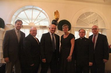 Seth Pelosso, CYO director of operations; Michael Neely, CYO assistant director; Larry Ambrosino, honoree; Jeannine Roland, honoree; Rev. Michael Martine, honoree and Ed Broderick, director of the CYO Archdiocese of New York, pose for a photo before the annual CYO Shining Star Awards Brunch. (Stateb Island Advance/Vincent Barone)