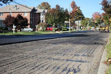 A few hundred yards of West Fingerboard Road will be the city's testing ground for rubberized asphalt. The city hopes the rubberized asphalt can increase the durability of Island roads. (Staten Island Advance/Vincent Barone)