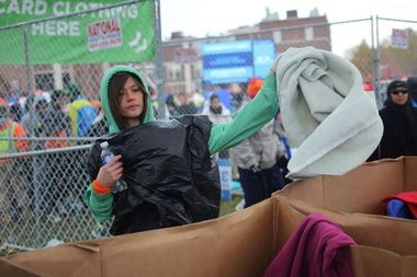 Sonja Tanaka, of Paris, donates her clothes to Goodwill before running in the 2014 New York City Marathon. (Staten Island Advance/Vincent Barone)