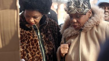 Cynthia Davis, NAN Staten Island President, and Gwen Carr, mother of Eric Garner, visit Garner's memorial in Tomkinsville on Thursday morning. (Staten Island Advance/Vincent Barone)