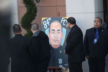 A mural of slain NYPD officer Rafael Ramos was displayed outside of Christ Tabernacle Church in Glendale, Queens, before the funeral service began. (Staten Island Advance/Vincent Barone)