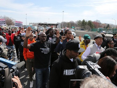 "Protesters chant ""Hands up-Don't Shoot"" as they make their way to the Outerbridge Crossing as Justice League NYC and Gathering for Justice organizations host a March 2 Justice march against police brutality. Monday April 13, 2015. (Staten Island Advance/Anthony DePrimo)"