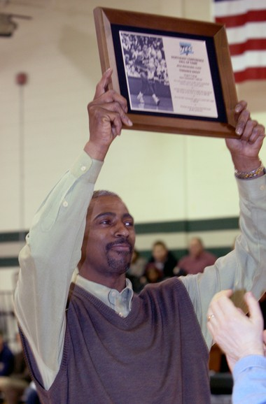 Ex-Wagner College star Terrance Bailey shows off a plaque while being honored during a Wagner game in 2011.
