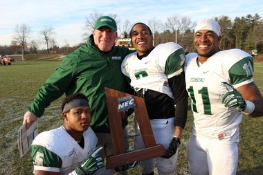 Wagner assistant head coach/offensive coordinator Jason Houghtaling will be introduced as the school's new head football coach Tuesday at the Spiro Center. He poses with running backs Brandon Peoples (5), Otis Wright (3) and Matthias McKinnon (11) after they claimed a share of the NEC championship Saturday with a 23-20 victory at Bryant.
