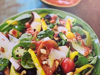 """Spinach salad with Manchego and Bloody Mary vinaigrette. (From """"Recipes Around the World: My Life on a Plate"""" by Kelis Rogers (Kyle Books:2015))"""