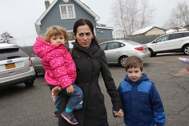 "Bay Terrace resident Alketa Zhabjaku, who was shopping at Rite-Aid on Wednesday with her two children, Arela, 17-months and Arlind, 4-years-old said, ""I'm not happy they are closing because a lot of people shop here for the pharmacy, and usually the store has good deals."""