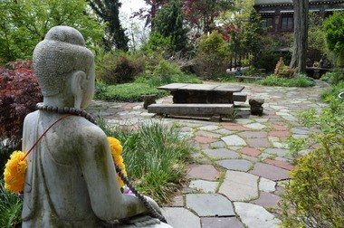 A statue of Buddah watches over the garden at the Jacques Marchais Museum of Tibetan Art.(Staten Island Advance/ Bill Lyons)