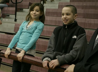A 2006 photo of 8-year-old Casey and 12-year-old Pete Davidson watch the fourth annual College of Staten Island Tournament of Heroes basketball game, held in school's Sports and Recreation Center. (STATEN ISLAND ADVANCE/NICHOLAS FEVELO)