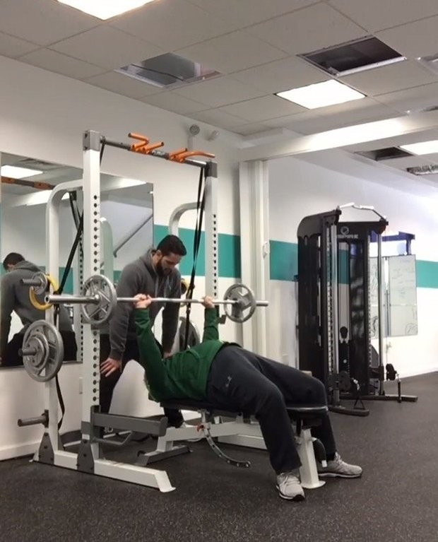 Matt Geib, a personal trainer at Transformation Fitness in Graniteville, is shown working with his client, Raymond Cottrell, during a recent workout.