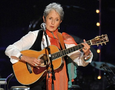 Joan Baez performs at a benefit concert celebrating Pete Seeger's 90th birthday in 2009. Ms. Baez was born on Staten Island and lived in Westerleigh as a child.