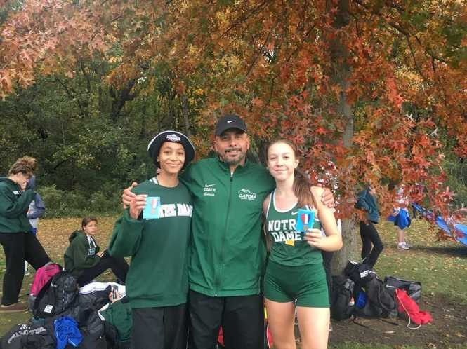 Alyssia Brown and Giavanna Comerford with NDA coach Al Garcia.