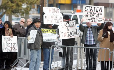 Frustrated Staten Island motorists rally in Arrochar to protest the $15 toll at the Verrazano-Narrows Bridge, scheduled to start in March.