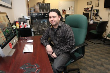 Chris Spinella owns a graphic design company called Chris Nipz Design, here in his office on South Ave.