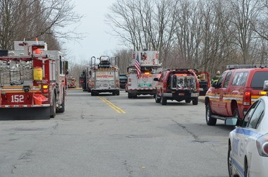 Firefighters responding to a brush fire at Olympia Boulevard and Quintard Street. Staten Island Advance/ Ryan Lavis