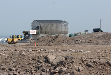 In this photo 2002 photo, the last sifting machine at the Fresh Kills Landfill is seen in the background.