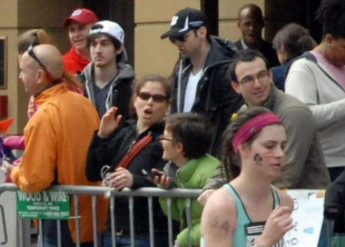 This Monday, April 15 photo provided by Bob Leonard shows Tamerlan Tsarnaev, third from left, who was dubbed Suspect No. 1 and second from left, Dzhokhar A. Tsarnaev, who was dubbed Suspect No. 2 in the Boston Marathon bombings by law enforcement. This image was taken approximately 10-20 minutes before the blast.