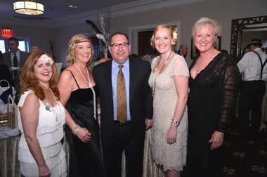 Co-chairs Colleen Sorrentino and Teresa Pelosi with Albert Cauz, Head of School, and auctioneers Erin Ward and Jill Doherty, at Staten Island Academy's 37th annual auction at the Richmond County Country Club in Dongan Hills on Saturday.