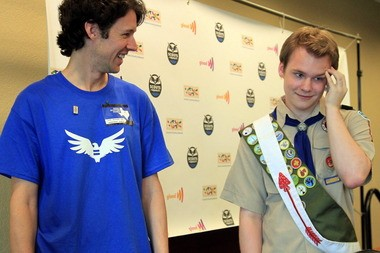 Pascal Tessier accepts congratulations in Grapevine, Texas, after National Council adopted compromise that allows openly gay youths as Boy Scouts. Tessier's Eagle Scout certification depended on passage of the resolution.