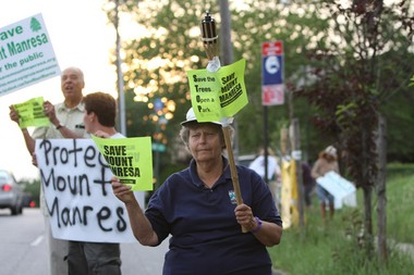 Concerned Islanders, including Lynn Phimister, have been demonstrating against the sale of the retreat house on Fingerboard Road since it was announced in May.