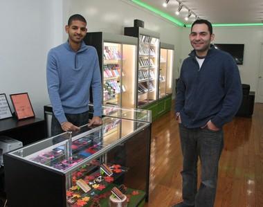 Basm Moshen and Joseph DiPierno in Healix Smartphone Repair store, New Dorp.