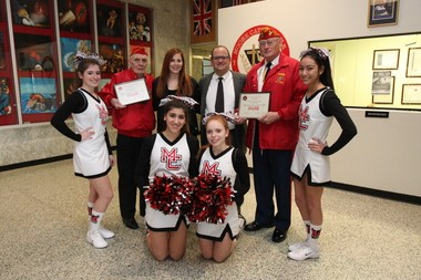 The Marine Corps League presented a plaque to the cheerleaders of Moore Catholic High School for their donation of holiday toys. On hand were Rachel Colangelo, Mike Valenzo, Kim Kukal, Robert Manisero, Volker Heyde, Samantha Gavin, Julianne Marsala and Micheala Black.