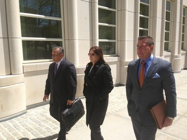 Diana Durand, center, enters Brooklyn federal court with attorneys Joseph Sconzo, left, and Stuart Kaplan.