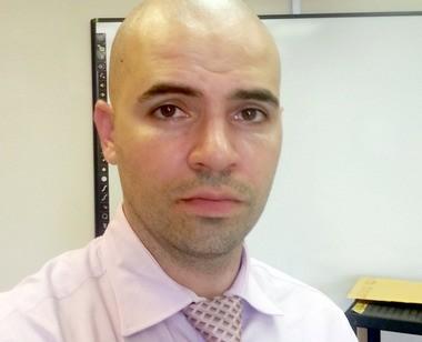 Exiled Dreyfus Intermediate School teacher Francesco Portelos says he will be allowed to return to the classroom.