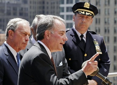 Ivan Seidenberg, center, chairman of Verizon, talked at a news conference overlooking the World Trade Center site in May 2011, with Mayor Michael Bloomberg and the Deputy Chief Charles Dowd.