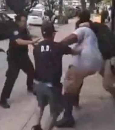 Cell phone video showing a police officer dragging Eric Garner, 43, to the floor after putting him in what appears to be a chokehold outside a beauty supply store in Tompkinsville. (Courtesy of Youtube)