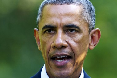 President Barack Obama speaks Monday about developments in Iraq from his vacation residence in Chilmark, Mass., during his family vacation on the island of Martha's Vineyard. (Associated Press)