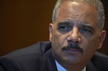 In this Sept. 16, 2014 file photo, Attorney General Eric Holder speaks during an interview with The Associated Press at the Justice Department in Washington.