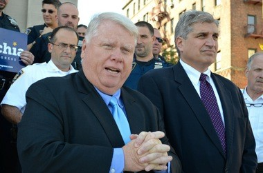 Dennis Quirk, president of New York State Court Officers Association, left, gives Democrat Domenic Recchia the union's endorsement Tuesday on the steps of state Supreme Court, St. George.